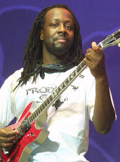 Wyclef Jean performing with guitar