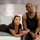 Image 5: Kanye West and Kim Kardashian on bed
