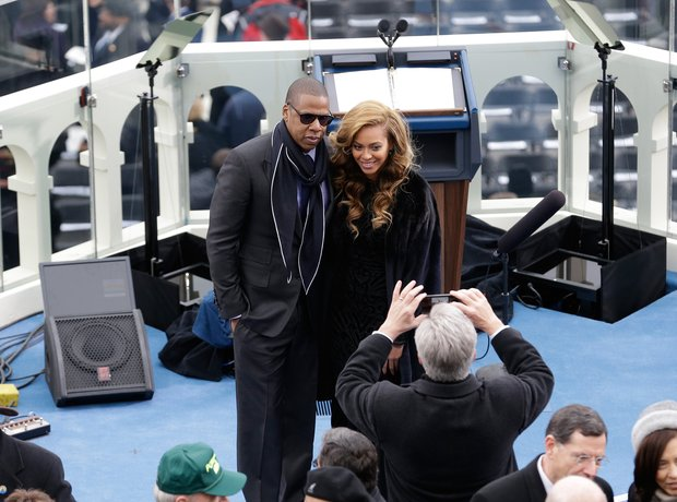 Beyonce (R) and Jay-Z arrive at the ceremonial sw