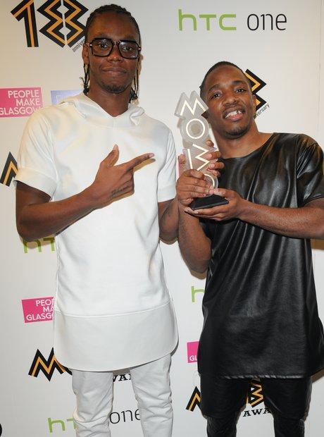 Konan holding their award at the Mobo Awards 2013
