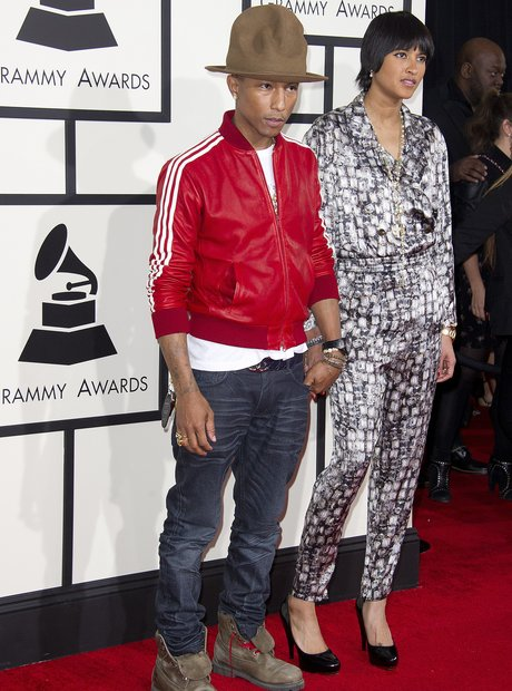 Pharrell and his wife Grammys Arrivals 2014