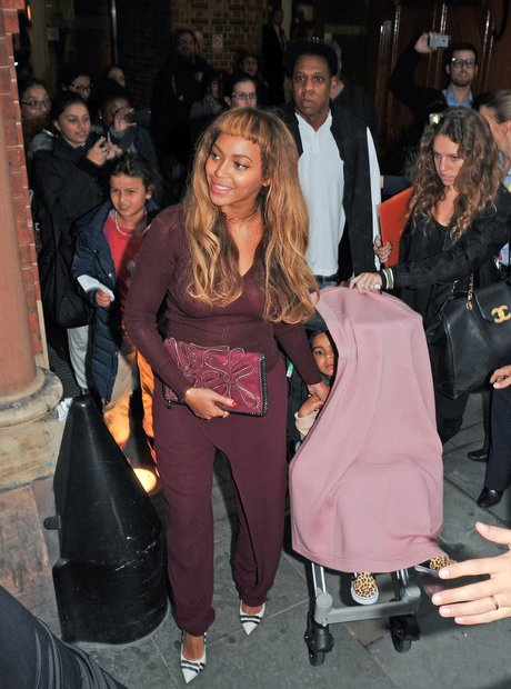 Beyonce with new fringe arriving in London