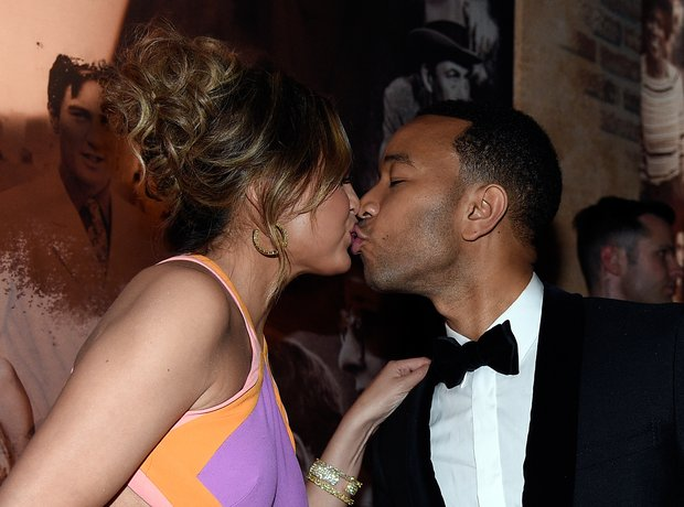 Chrissy Teigen kisses John Legend