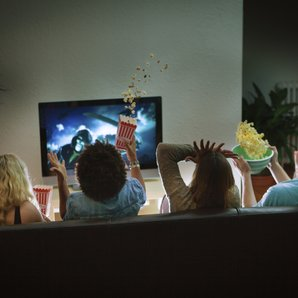 Friends watching nighttime tv