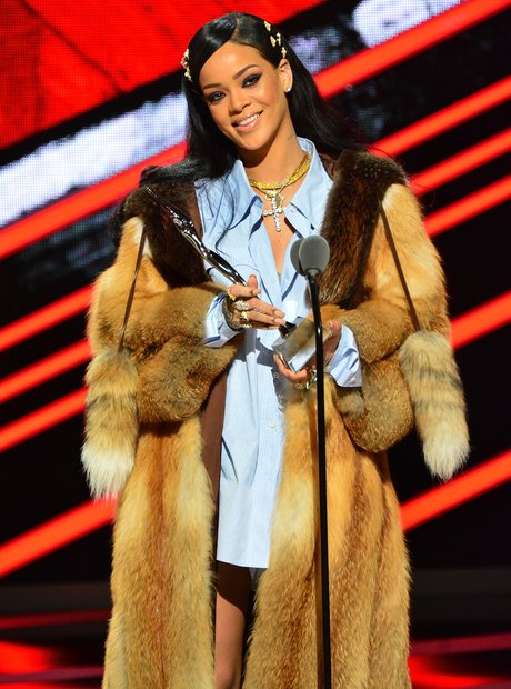 Rihanna accepting award on stage