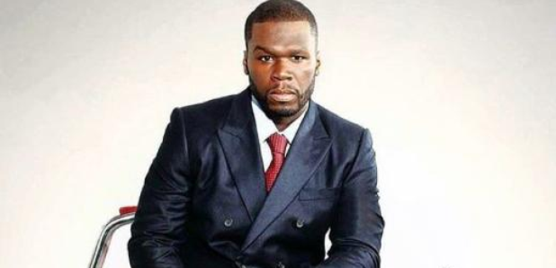 50 Cent sat on car