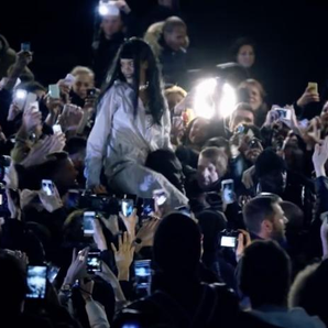 Rihanna crowd surfing with fans