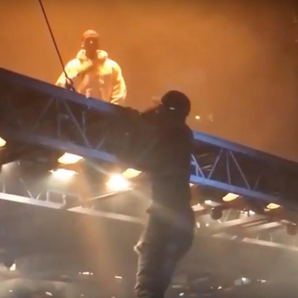 Kanye West Fan climbing floating stage
