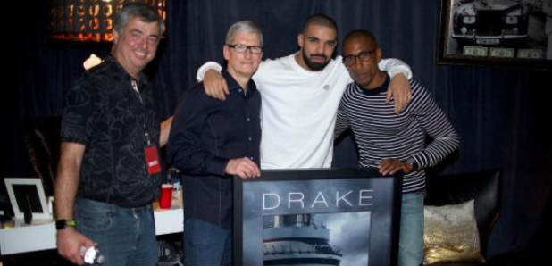 Drake holding plaque