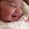 Image 1: Dream Kardashian is pictured smiling